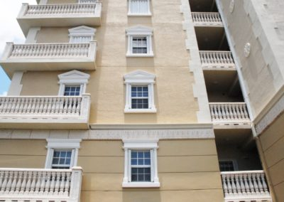 1920-01 Multi 18, Venetian Condos, pidement on windows, ballusters, medallion, precast stone, quoins