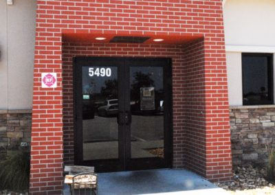 1920-EIFS 3, brick, stone entrance, Slow & Lo BBQ